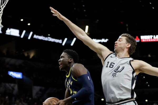 Indiana Pacers guard Victor Oladipo (4) drives to the basket past San Antonio Spurs center Pau Gasol (16) during the first half of an NBA basketball game, Sunday, Jan. 21, 2018, in San Antonio. (AP Photo/Eric Gay)