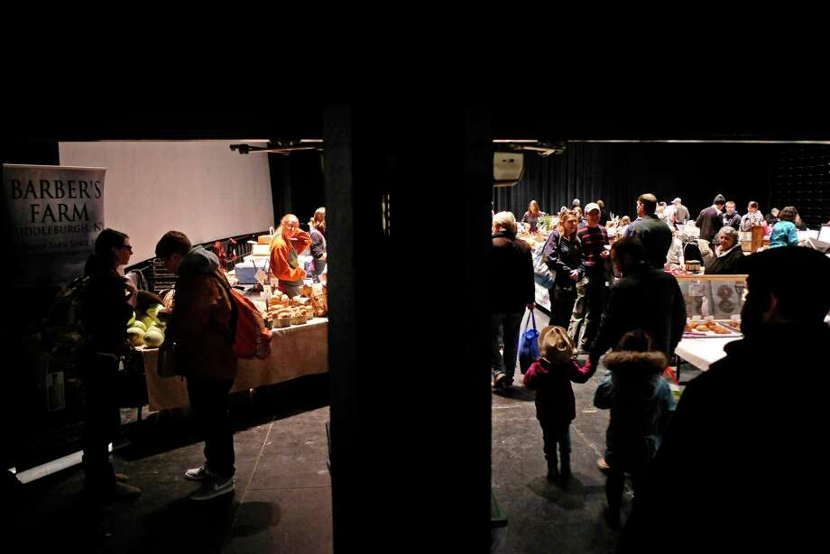 People make their way around to different vendors at the Greenmarket Winter Market inside Proctors on Sunday, Jan. 21, 2018, in Schenectady, N.Y.  The market is held each Sunday from 10 a.m. to 2 p.m.  (Paul Buckowski/Times Union) Photo: PAUL BUCKOWSKI / (Paul Buckowski/Times Union)