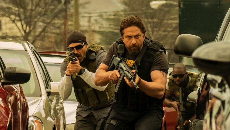 """From left: Gerard Butler, Maurice Compte and Mo McRae in """"Den of Thieves"""" credit: STX Entertainment"""