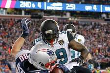 Danny Amendola (80) of the New England Patriots catches a touchdown pass as he is defended by Tashaun Gipson (39) of the Jacksonville Jaguars in the fourth quarter during the AFC Championship Game at Gillette Stadium on Sunday in Foxborough, Mass.