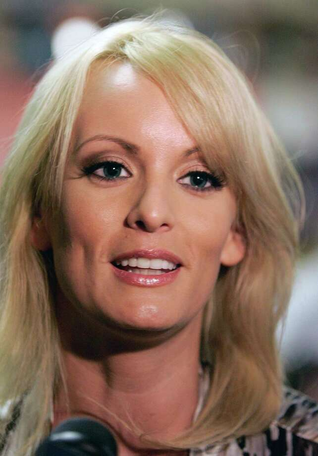File- This May 6, 2009, file photo shows Stormy Daniels visiting a local restaurant in downtown New Orleans. A tabloid magazine held back from publishing Daniels' 2011 account of an alleged affair with Donald Trump after the future president's personal lawyer threatened to sue, four former employees of the tabloid's publisher told The Associated Press. (AP Photo/Bill Haber, File) Photo: Bill Haber, STF / AP2009