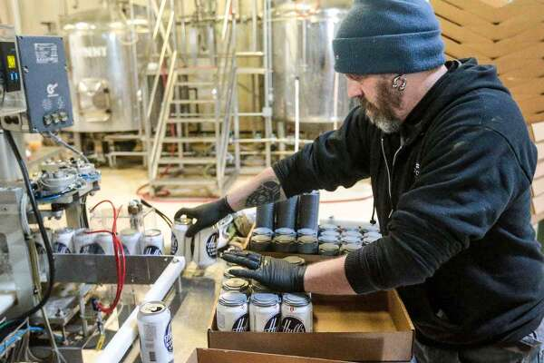 Cans of Hull's Export Lager Beer are packed up at Overshores Brewery in East Haven. Entrepreneur Chuck DelVecchio bought the recipe and is bringing the brand back to the area.