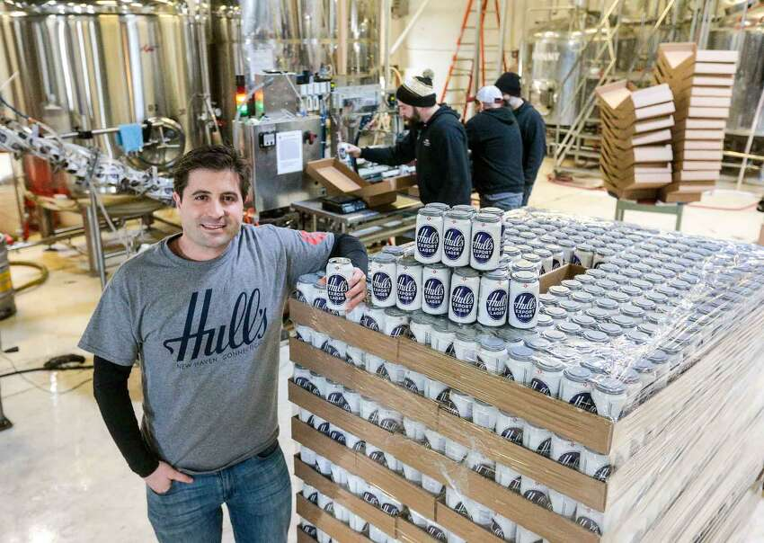 Chuck DelVecchio stands with his first shipment of the classic Hull's Export Lager Beer in Overshores Brewery in East Haven. DelVecchio bought the original recipe and contracted with Overshores to produce it. The brew will hit the markets shortly.