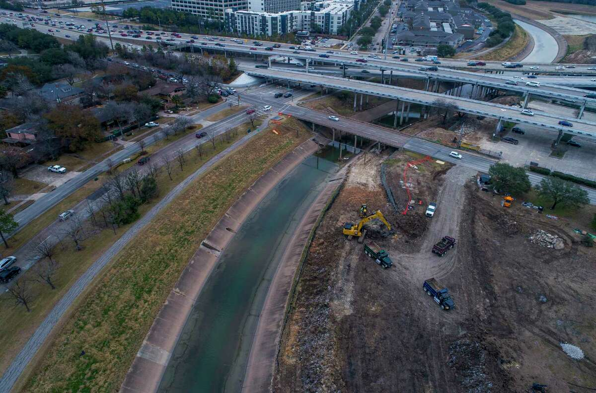 An excavator works on an area along Brays Bayou near the 610 Loop in the Meyerland area, which has flooded three times since May 2015.