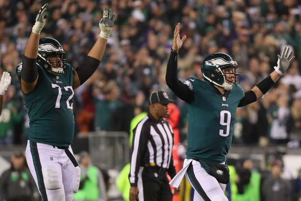 PHILADELPHIA, PA - JANUARY 21:  Nick Foles #9 of the Philadelphia Eagles celebrates a first quarter touchdown against the Minnesota Vikings in the NFC Championship game at Lincoln Financial Field on January 21, 2018 in Philadelphia, Pennsylvania.  (Photo by Abbie Parr/Getty Images)