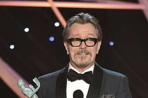"""Gary Oldman accepts the award for outstanding performance by a male actor in a leading role for """"Darkest Hour"""" at the 24th annual Screen Actors Guild Awards at the Shrine Auditorium & Expo Hall on Sunday, Jan. 21, 2018, in Los Angeles. (Photo by Vince Bucci/Invision/AP)"""