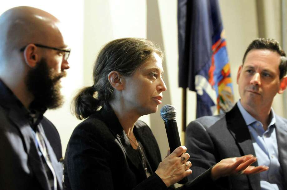 "Opera Saratoga librettist Stephanie Fleischmann, center, talks about her part in developing the opera ""The Long Walk,"" on Thursday, March 12, 2015, at the New York State Military Museum in Saratoga Springs, N.Y. Joining her are Opera Saratoga composer Jeremy Howard Beck, left, and Opera Saratoga artistic and general director Lawrence Edelson. A reading, discussion and performance introduced an opera based on Brian Castner's Iraq War memoir. (Cindy Schultz / Times Union) Photo: Cindy Schultz / 00030993A"