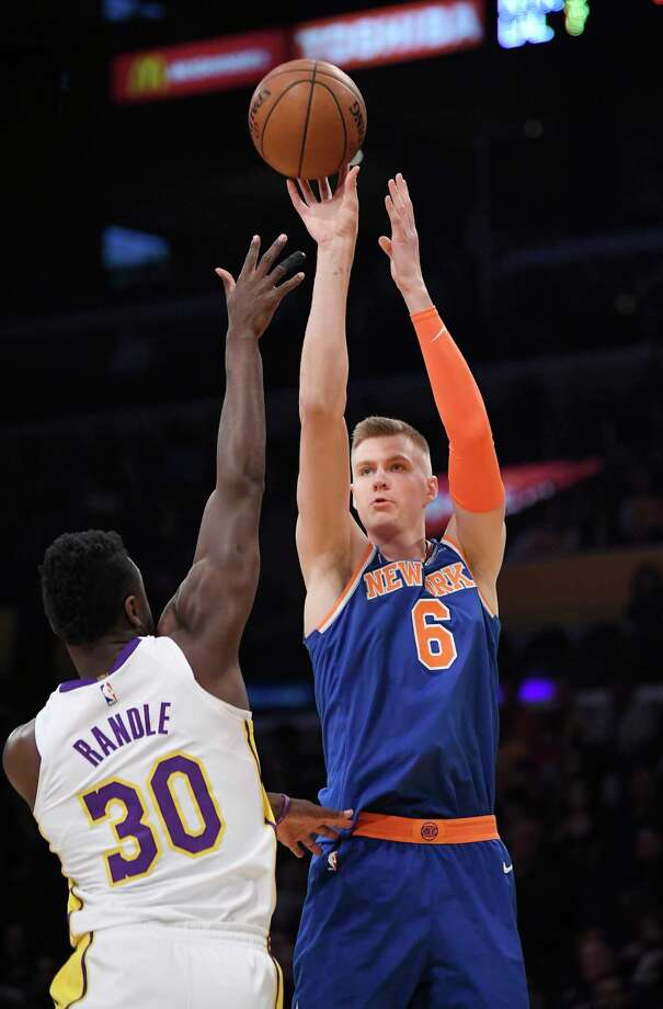 New York Knicks forward Kristaps Porzingis, right, of Latvia, shoots as Los Angeles Lakers forward Julius Randle defends during the first half on an NBA basketball game, Sunday, Jan. 21, 2018, in Los Angeles. (AP Photo/Mark J. Terrill) Photo: Mark J. Terrill / Copyright 2018 The Associated Press. All rights reserved.