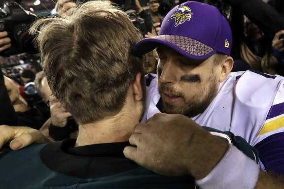 Philadelphia Eagles' Nick Foles hugs Minnesota Vikings' Case Keenum after the NFL football NFC championship game against the Minnesota Vikings Sunday, Jan. 21, 2018, in Philadelphia. The Eagle won 38-7 to advance to Super Bolw LII. (AP Photo/Michael Perez)