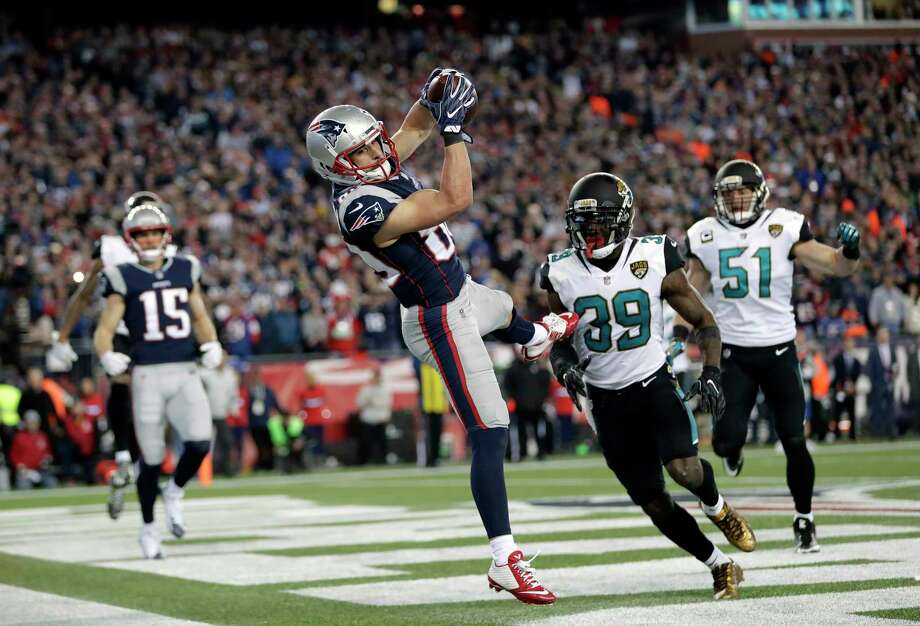 New England Patriots wide receiver Danny Amendola (80) catches a touchdown pass in front of Jacksonville Jaguars safety Tashaun Gipson (39) and linebacker Paul Posluszny (51) during the second half of the AFC championship NFL football game, Sunday, Jan. 21, 2018, in Foxborough, Mass. (AP Photo/David J. Phillip) Photo: David J. Phillip / Copyright 2018 The Associated Press. All rights reserved.