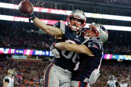 New England Patriots wide receiver Danny Amendola, left, celebrates his touchdown catch with Chris Hogan, right, during the second half of the AFC championship NFL football game against the Jacksonville Jaguars, Sunday, Jan. 21, 2018, in Foxborough, Mass. (AP Photo/David J. Phillip)