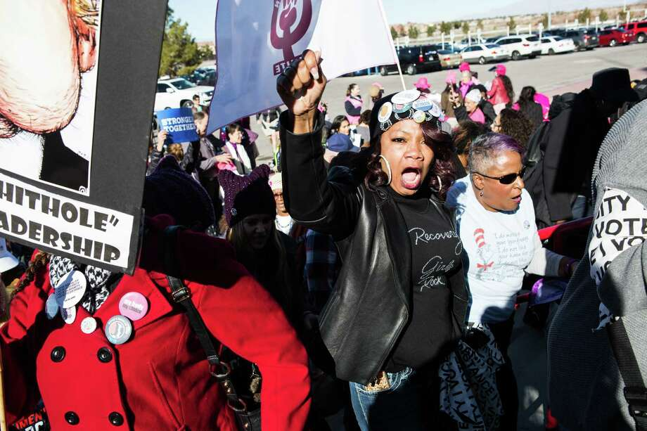 Attendees carry signs and chant before entering the Sam Boyd Stadium during the Women's March One-Year Anniversary: Power To The Polls event in Las Vegas, Nevada, U.S., on Sunday, Jan. 21, 2018. On the anniversary of the Women's March, the Power to the Polls rally aims at a tighter objective, to launch a national voter registration and mobilization tour with a goal to elect more women and progressive candidates to public office. Photographer: Michelle Gustafson/Bloomberg Photo: Michelle Gustafson / © 2018 Bloomberg Finance LP