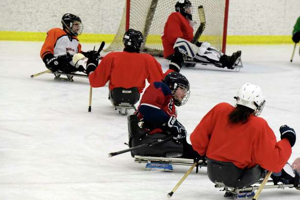Members of the Capital District STRIDE Sled Warriors hockey team take part in practice at the Albany County Hockey Facility on Sunday, Jan. 21, 2018, in Albany, N.Y.  The sled hockey team, which was started ten years ago, will compete in the winter Empire State Games in Lake Placid in early February.  Last year the STRIDE hockey team took home the Bronze Medal.  This years team is made up of 18 players.  The STRIDE Adaptive Sports hockey team is comprise of those with mental or physical disabilities or combat injured veterans.  Anyone interested in joining the team can email STRIDE's program director, Megan Evans,  mevans@stride.org .    (Paul Buckowski/Times Union)