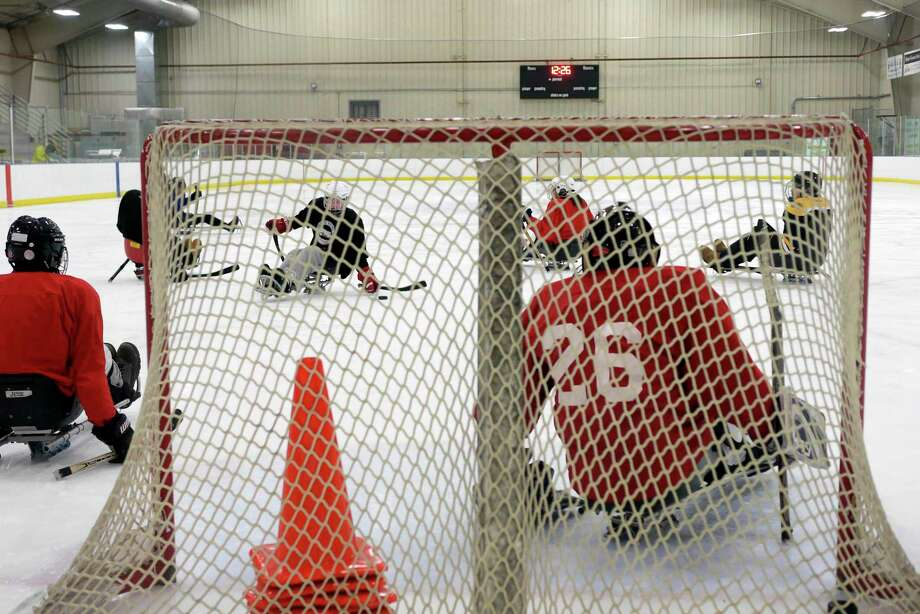 Members of the Capital District STRIDE Sled Warriors hockey team take part in practice at the Albany County Hockey Facility on Sunday, Jan. 21, 2018, in Albany, N.Y.  The sled hockey team, which was started ten years ago, will compete in the winter Empire State Games in Lake Placid in early February.  Last year the STRIDE hockey team took home the Bronze Medal.  This years team is made up of 18 players.  The STRIDE Adaptive Sports hockey team is comprise of those with mental or physical disabilities or combat injured veterans.  Anyone interested in joining the team can email STRIDE's program director, Megan Evans, mevans@stride.org.    (Paul Buckowski/Times Union) / (Paul Buckowski/Times Union)