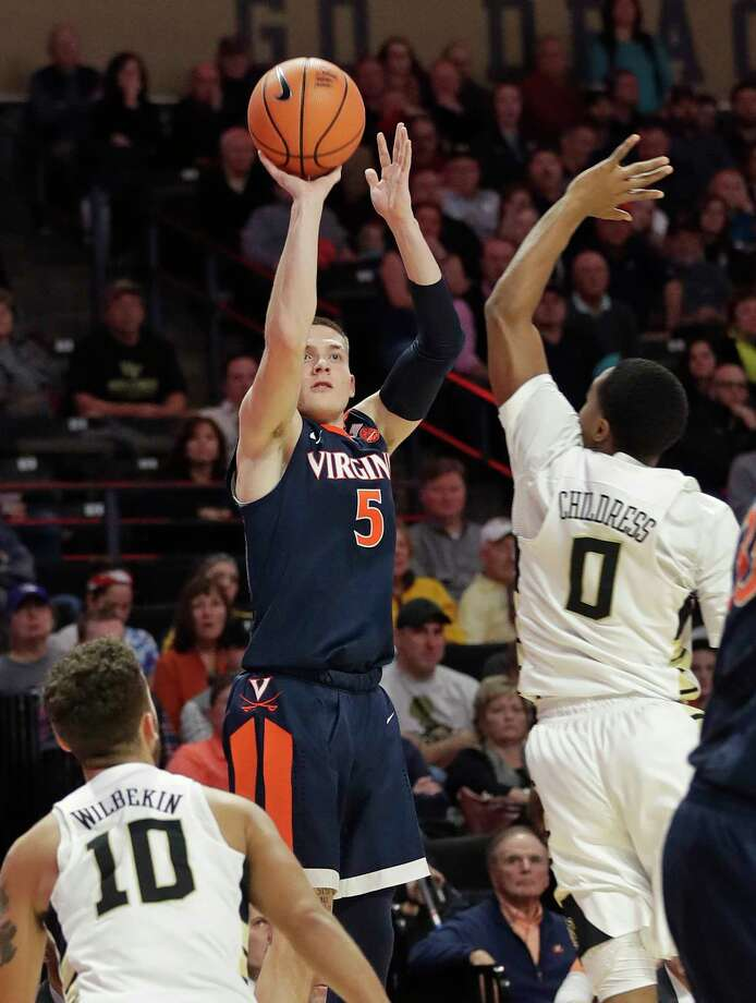 Virginia's Kyle Guy (5) shoots over Wake Forest's Brandon Childress (0) during the second half of an NCAA basketball game in Winston-Salem, N.C., Sunday, Jan. 21, 2018. (AP Photo/Chuck Burton) Photo: Chuck Burton / Copyright 2018 The Associated Press. All rights reserved.