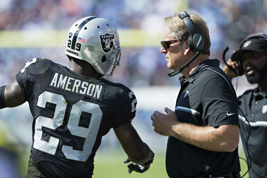 NASHVILLE, TN - SEPTEMBER 25:  Head Coach Jack Del Rio talks with David Amerson #29 of the Oakland Raiders during a timeout during a game against the Tennessee Titans at Nissan Stadium on September 25, 2016 in Nashville, Tennessee.  The Raiders defeated the Titans 17-10.  (Photo by Wesley Hitt/Getty Images) ORG XMIT: 659210013 Photo: Wesley Hitt / 2016 Getty Images