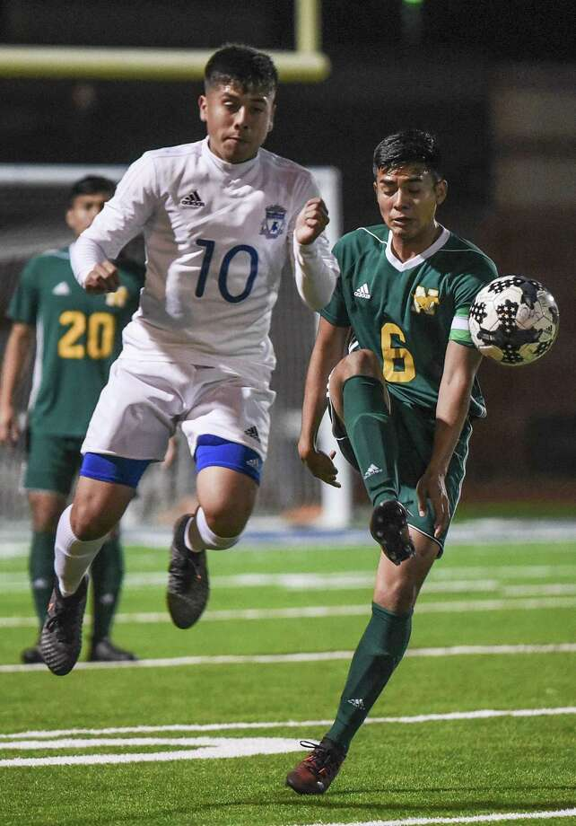 Nixon's Juan Cornejo and Cigarroa's Donald Hernandez battle for ball. The Toros topped the Mustangs 3-1 on their home turf Saturday. Photo: Danny Zaragoza /Laredo Morning Times