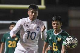 Nixon's Juan Cornejo and Cigarroa's Donald Hernandez battle for ball. The Toros topped the Mustangs 3-1 on their home turf Saturday.