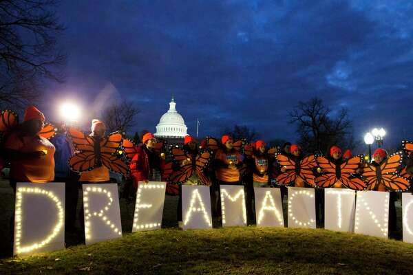 """Demonstrators rally in support of Deferred Action for Childhood Arrivals (DACA) outside the Capitol, Sunday, Jan. 21, 2018, in Washington, on the second day of the federal shutdown. Democrats have been seeking a deal to protect the """"Dreamers,"""" who have been shielded against deportation by DACA, which President Donald Trump halted last year."""