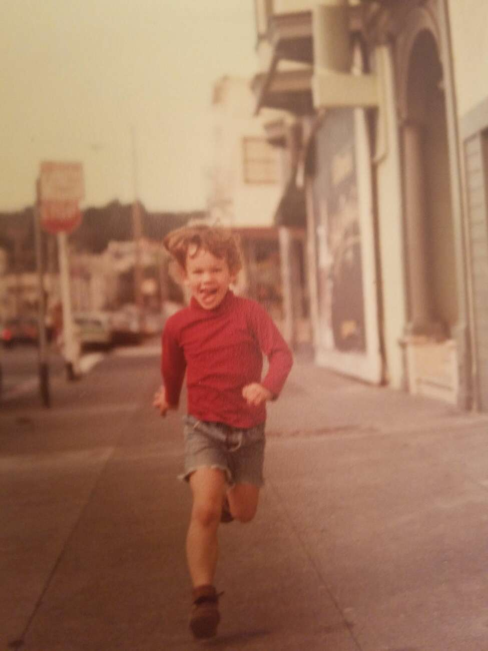 2. A chunk of my childhood was spent in San Francisco. This is me running down the sidewalk near our apartment in the Richmond District.