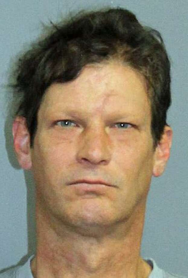 """An Oxford man has been arrested on charges that he killed a cat in his backyard with a .22-caliber rifle. State Police say Craig Middendorf, 48, """"was annoyed at what he believed to be a stray cat so he shot and killed it in the backyard."""" The cat was the pet of a woman who lived next door to Middendorf on Roosevelt Drive. Photo: State Police Photo"""