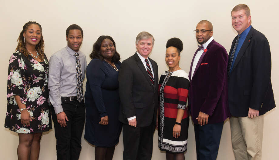 Celebrating another Dr. Martin Luther King Jr. Birthday Celebration at SIUE from left to right: community humanitarian award winner Desiree Tyus, scholarship winner Jonathan Amwayi, faculty humanitarian award winner Dr. Jessica Harris, Chancellor Randy Pembrook, featured speaker Dr. Shonta Smith, staff humanitarian award winner Shawn Roundtree and Vice Chancellor for Student Affairs Jeffrey Waple. Photo: For The Intelligencer