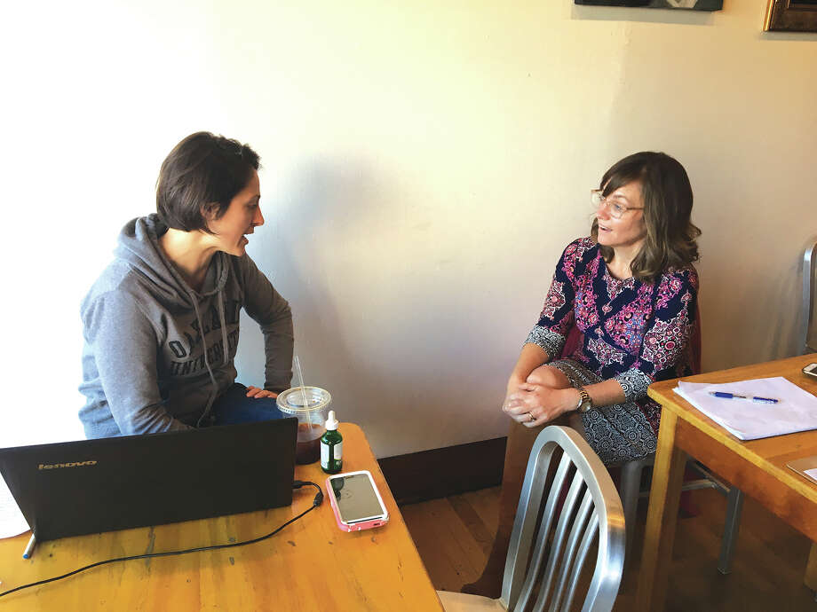 State Representative Katie Stuart, D-Edwardsville, meets with an area resident on Jan. 13 during a Coffee with Katie event at Sacred Grounds Cafe in downtown Edwardsville. Stuart regularly hosts such events throughout her district to allow constituents to ask questions and voice concerns. Photo: Bill Tucker • Btucker@edwpub.net