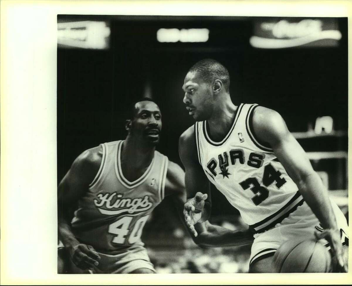 1988 file photo. Spurs Mike Mitchell defended by Sacramento's Terry Tyler.