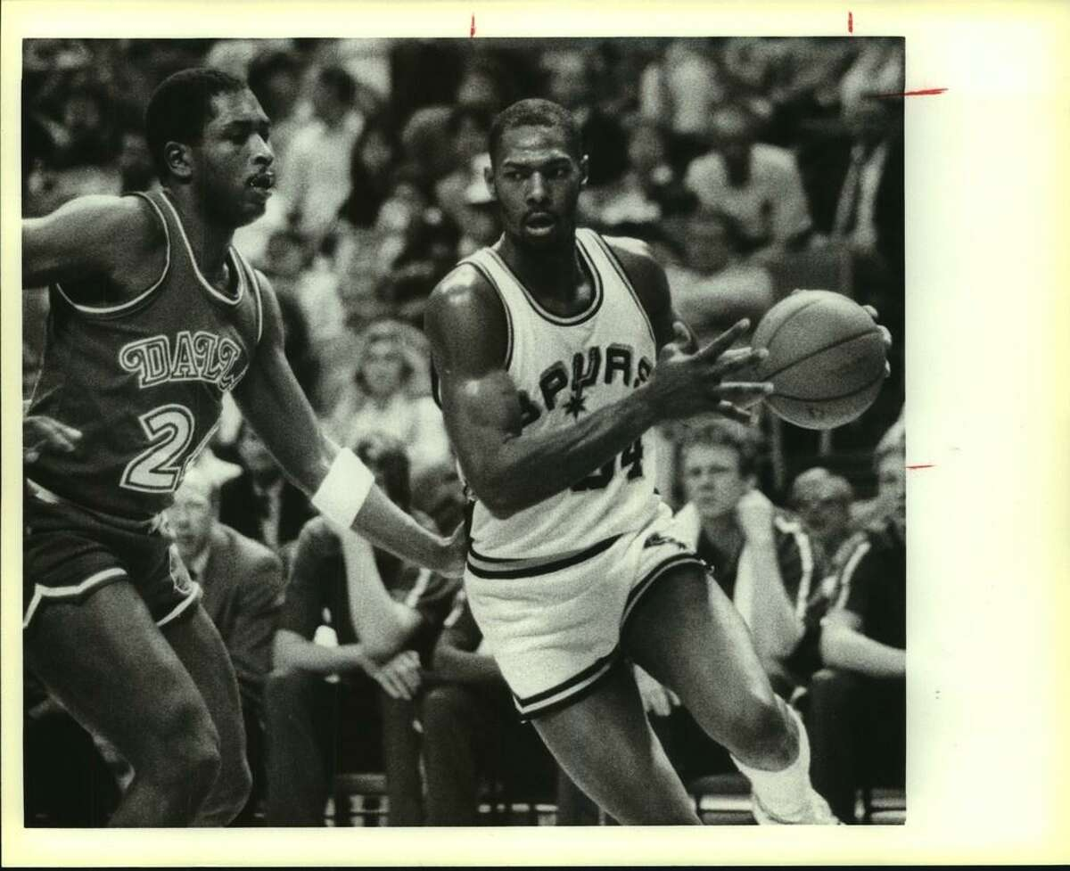 1985 file photo: Spurs Mike Mitchell drives past Dallas' Mark Aguirre.