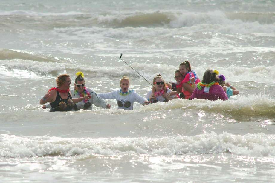 Representatives from the Nippy Bips team made up of members of League City American Legion Post 554 and of employees from Clear Creek ISD waded into chilly waves in Galveston on Saturday to raise money for Special Olympics during the Special Olympics Polar Plunge. Photo: Kirk Sides / © 2018 Kirk Sides / Houston Chronicle
