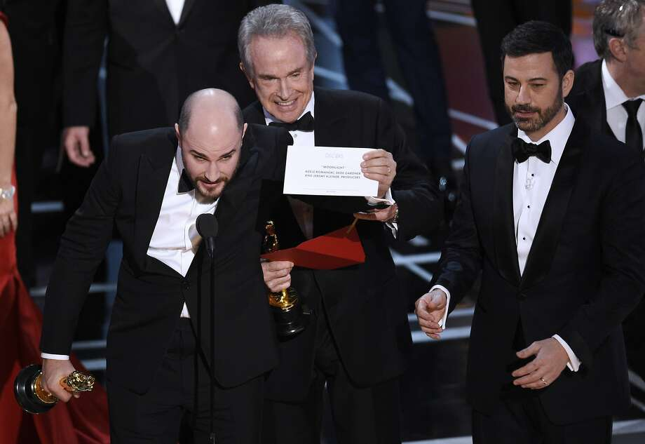 "FILE - In this Feb. 26, 2017, file photo, Jordan Horowitz, producer of ""La La Land,"" left, shows the envelope revealing ""Moonlight"" as the true winner of best picture at the Oscars in Los Angeles as presenter Warren Beatty and host Jimmy Kimmel, right, look on. The film academy and its accounting firm, PwC, are announcing a spate of new rules Monday, Jan. 22, 2018, meant to avoid an envelope gaffe like at last year's show, when ""La La Land"" was mistakenly announced as the winner instead of ""Moonlight."" PwC U.S. Chairman Tim Ryan said the new protocols include additional personnel and oversight, as well as practicing what to do if a presenter reads the wrong name. (Photo by Chris Pizzello/Invision/AP, File) Photo: Chris Pizzello, Associated Press"
