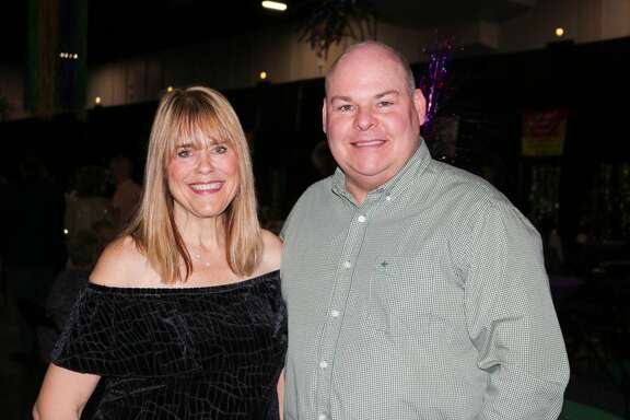 Laura Smith and Jeff Gerber were at the fourth annual Pardi Gras event Saturday night at the Beaumont Civic Center. Attendees got into the Mardi Gras spirit with gumbo, drinks, and music from Champagne Room at the event hosted by Southeast Texas Circle of Hope. Photo provided by Hannah LeTule
