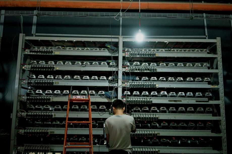 Li Shuangsheng, works at Bitmain, a Bitcoin farm in Dalad Banner, Mongolia, Aug. 11, 2017. Creating a single cryptocurrency token requires as much electricity as two yearsÕ worth of consumption by an average American home. (Giulia Marchi for The New York Times) Photo: GIULIA MARCHI, NYT / NYTNS