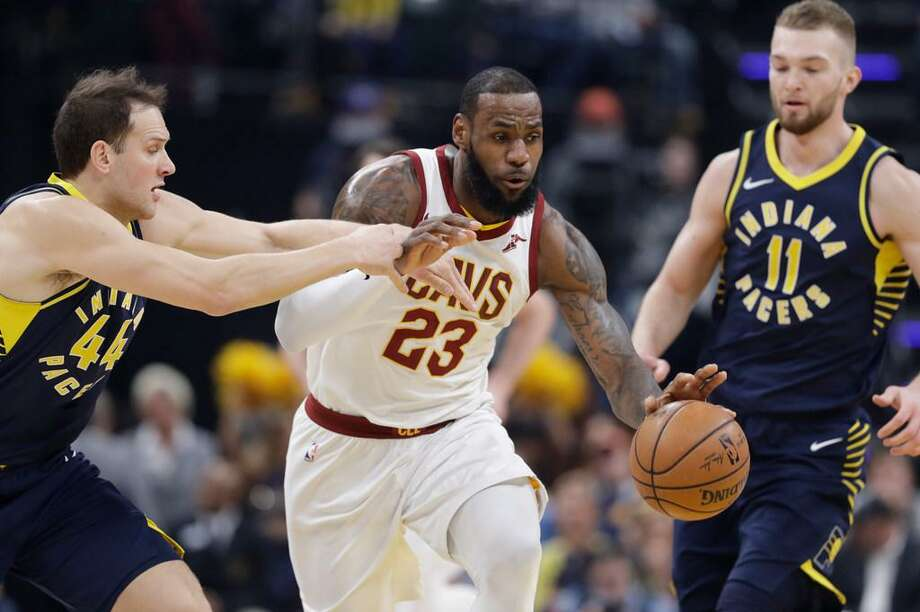 LeBron James rarely gets called for travelling according to Norman Chad. Here James dribbles against Indiana's Bojan Bogdanovic during a Jan. 12, 2018 game in Indianapolis. Photo: Darron Cummings /AP Photo