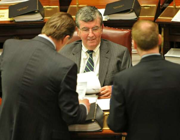 Senator Neil Breslin talks with a couple people before the start of a senate session in the Capitol in Albany, NY on May 10, 2010. (Lori Van Buren / Times Union) Photo: LORI VAN BUREN