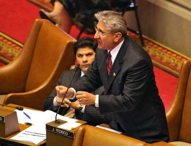 Assemblyman James Tedisco argues his point against the Governor's furlough plan with Assemblyman Herman Farrell, Jr. before a vote on the furlough at the Capitol in Albany, NY on May 10, 2010. (Lori Van Buren / Times Union) Photo: LORI VAN BUREN