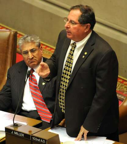 Assemblyman Joel Miller speaks during an assembly session in the Capitol in Albany, NY on May 10, 2010. Assemblyman James Tedisco listens next to him. (Lori Van Buren / Times Union) Photo: LORI VAN BUREN