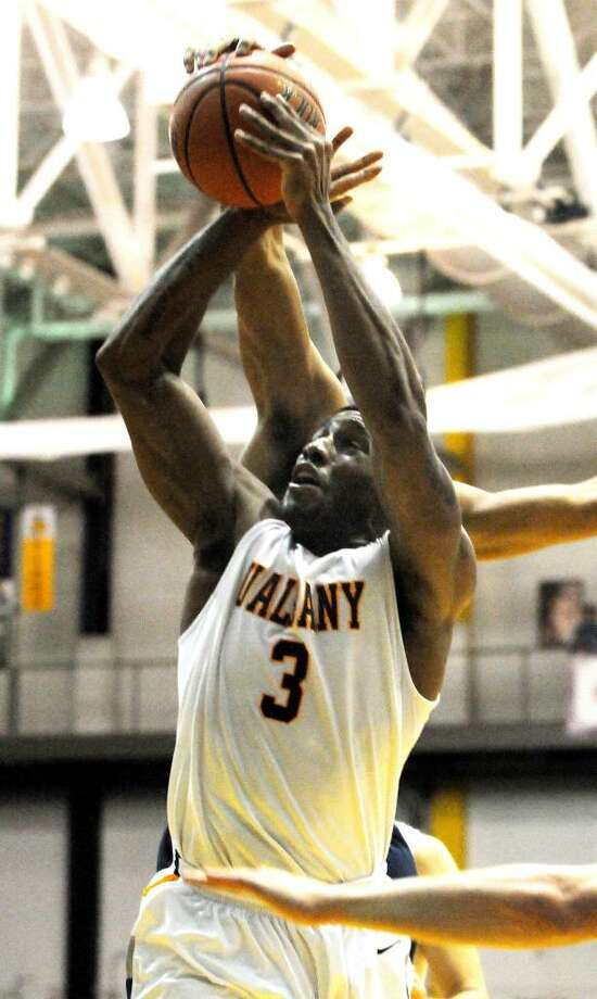 UAlbany's Will Harris goes up for a shot against Yale.  (Luanne M. Ferris / Times Union) Photo: LMF
