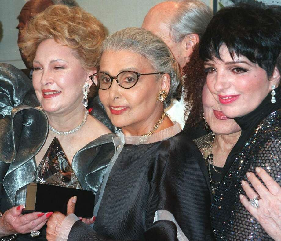 "In a June 23, 1997 file photo Ginny Mancini, left, and Lena Horne, center, hold  the Ella Award which was given to  Horne, on Monday, June 23, 1997, during the Society of Singers' Lena Horne 80th Birthday Gala in New York.   At right is Liza Minnelli. Singer Lena Horne, who broke racial barriers as a Hollywood and Broadway star famed for her velvety rendition of ""Stormy Weather,"" has died at age 92.  (AP Photo/Aubrey Reuben/file) Photo: AUBREY REUBEN / AP"