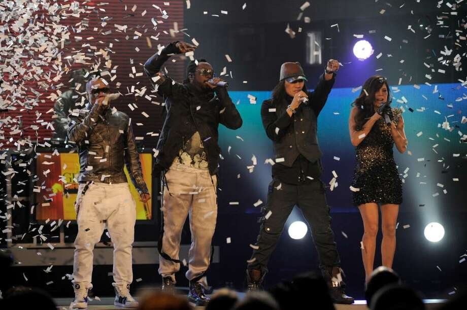 The Black Eyed Peas from left, apl.de.ap, will. i. am, Taboo, and Fergie, perform at the Grammy Nominations Concert on Wednesday, Dec. 2, 2009, in Los Angeles.  (AP Photo/Chris Pizzello) Photo: Chris Pizzello