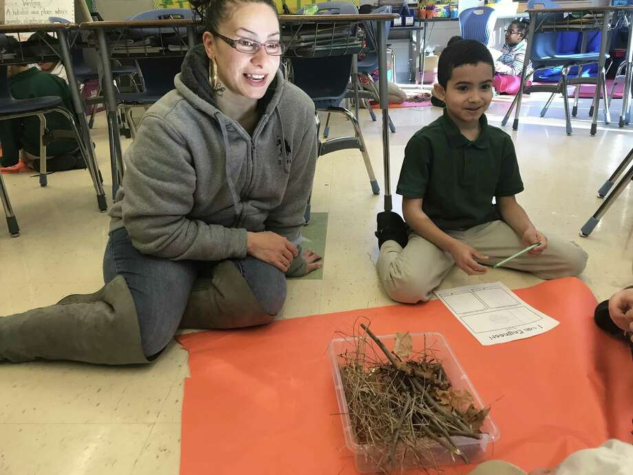 Ingrid Cruz works on a class project with son Jace Mirabal, 7, at Bishop Woods School. Photo: Brian Zahn/Hearst Connecticut Media