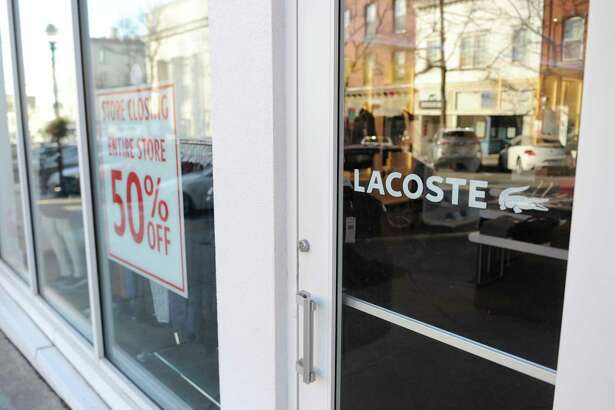 Men's fashion brand Lacoste, located at 98 Greenwich Ave., with a sign indicating the store is preparing to close in Greenwich, Conn. Thursday, Jan. 18, 2018.