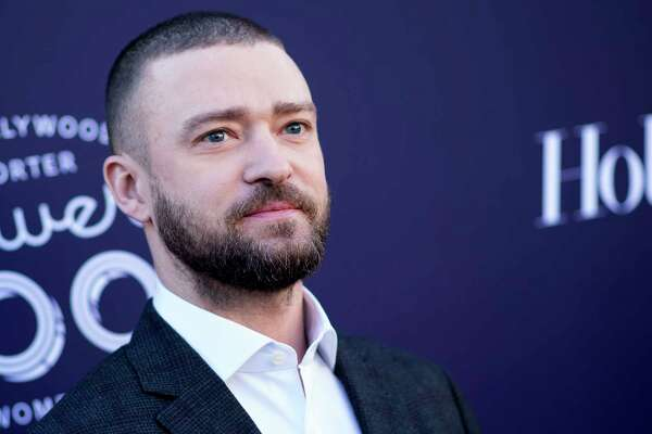 """(FILES) This file photo taken on December 6, 2017 shows actor/singer Justin Timberlake at The Hollywood Reporter 2017 Women In Entertainment Breakfast in Hollywood, California. Pop superstar Justin Timberlake on January 2, 2018 announced his first album in nearly five years, promising more """"personal"""" songwriting inspired by his home and family.The 36-year-old singer and actor said that """"Man in the Woods,"""" his fifth solo studio album, will come out on February 2 -- two days before he headlines entertainment during the Super Bowl, generally the most watched television event of the year in the United States.  / AFP PHOTO / VALERIE MACONVALERIE MACON/AFP/Getty Images"""