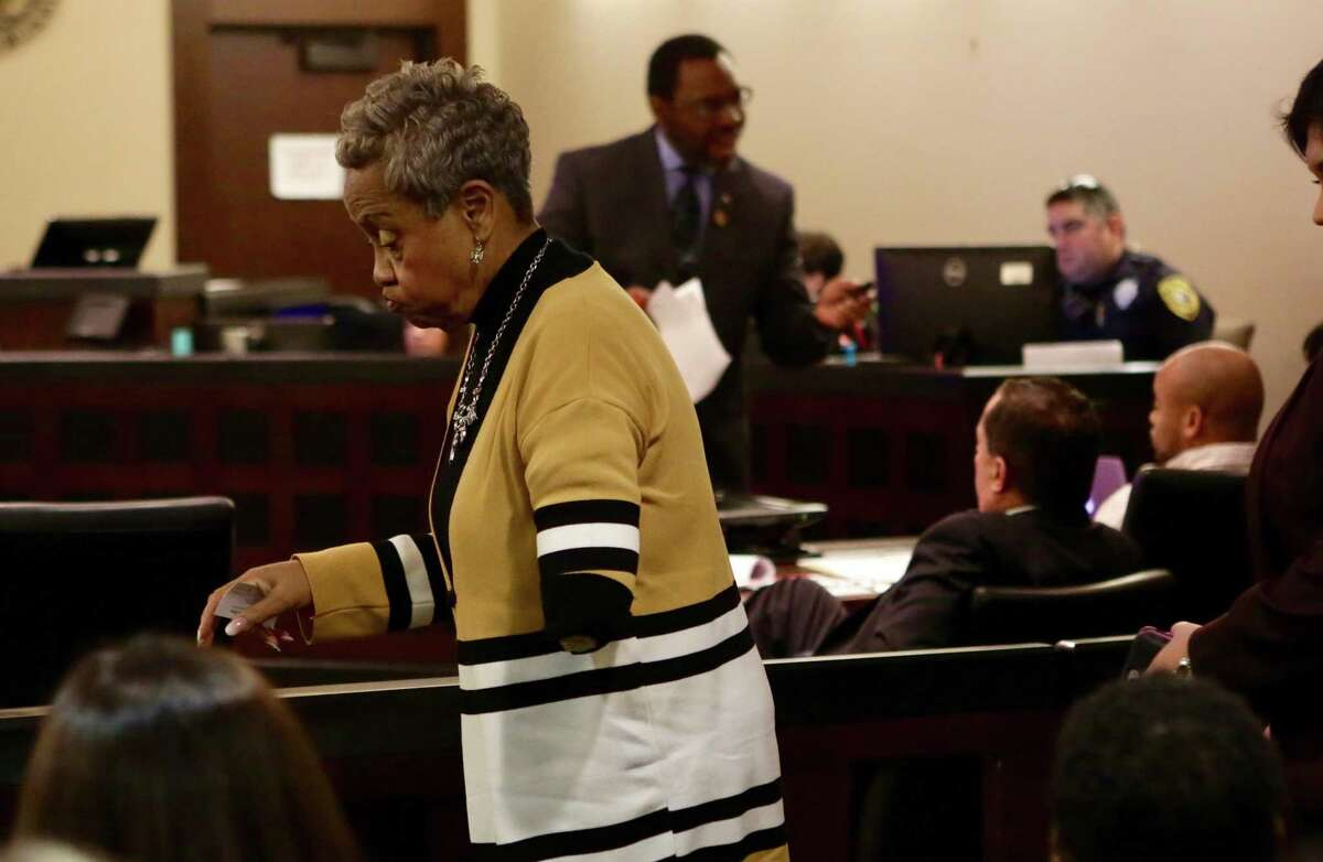 Doris Mixon Smith, left, whose arm was ripped off by a pit bull named Bully owned by Alphonso McCloud and his wife, Stanyelle McCloud, takes her seat in the 187th state District Court, presided by Judge Joey Contreras in the Cadena-Reeves Justice Center, on Monday, Jan. 22, 2018.