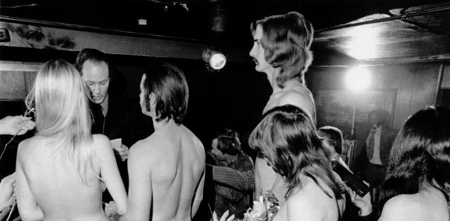 PHOTOS: Modern Texas weddings A couple gets married in a nude, double ring ceremony, Houston, Texas, on December 10, 1973. A Universal Life Church minister performs the ceremony.See how people get married in Texas these days... Photo: Underwood Archives/Getty Images