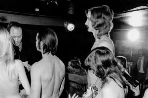 A couple gets married in a nude, double ring ceremony, Houston, Texas, on December 10, 1973. A Universal Life Church minister performs the ceremony.