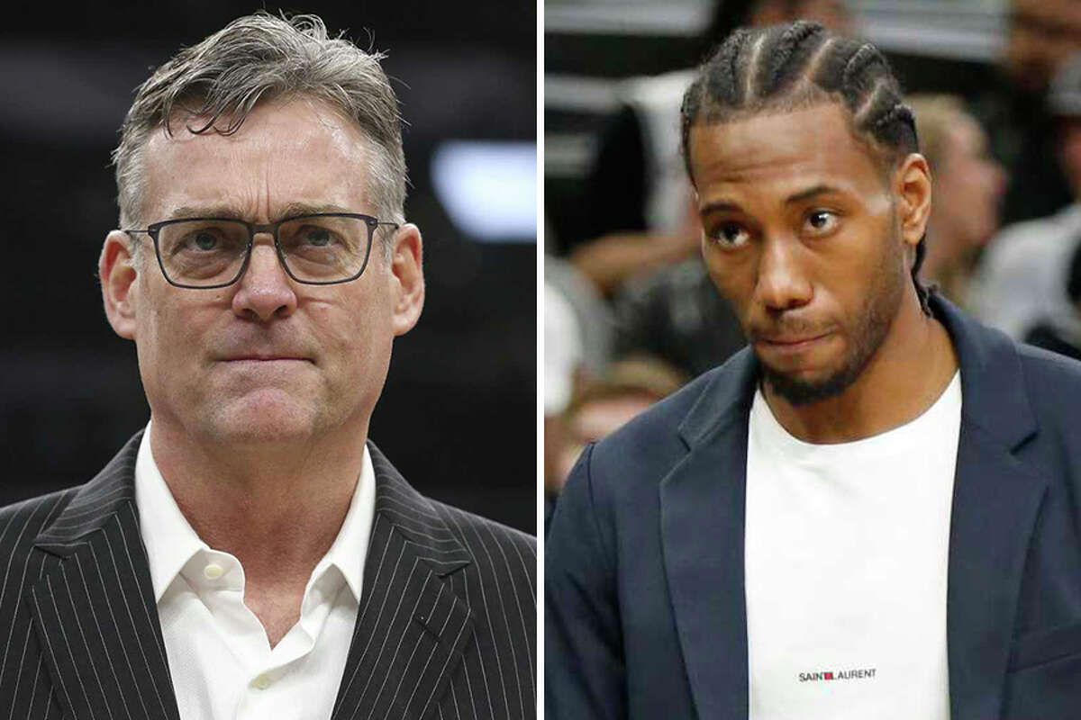 Spurs General Manager R.C. Buford, left, denies the organization has issues with Kawhi Leonard, following an ESPN story that the All-Star forward and team have experienced