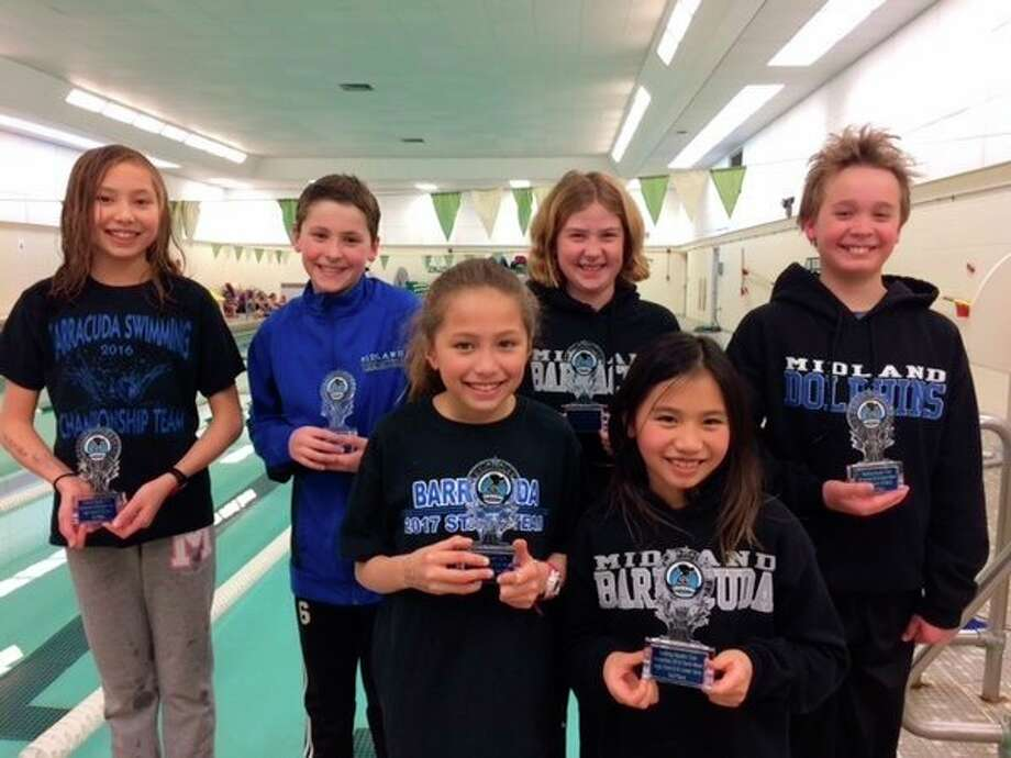 High point winners for the Midland Barracudas at the BAC Winterfest in Saline were (front row, from left) Vera Roberson (first place), Amy Casipit (third); (back row, from left) Ella Roberson (third), Eli Soderberg (fifth) Emily Thackery (eighth) and Eli Buist (sixth).