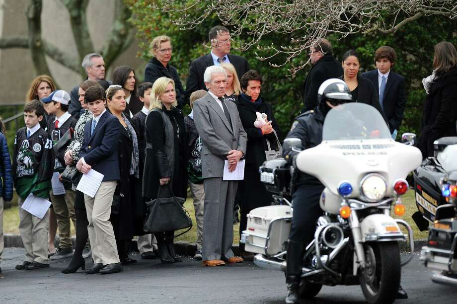 Mourners wait for the hearse carrying Nico Mallozzi, the 10-year old who died of the flu, to leave St. Aloysius Church in New Canaan on Monday. Photo: Michael Cummo / Hearst Connecticut Media / Stamford Advocate