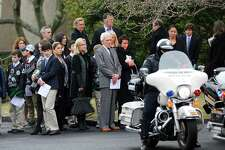 Mourners wait for the hearse carrying Nico Mallozzi, the 10-year old who died of the flu, to leave St. Aloysius Church in New Canaan on Monday.